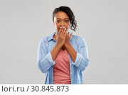 Купить «shocked african american woman covering her mouth», фото № 30845873, снято 2 марта 2019 г. (c) Syda Productions / Фотобанк Лори