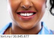 Купить «close up of african american woman white teeth», фото № 30845877, снято 2 марта 2019 г. (c) Syda Productions / Фотобанк Лори