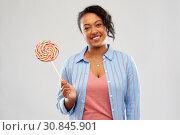 Купить «happy african american woman with big lollipop», фото № 30845901, снято 2 марта 2019 г. (c) Syda Productions / Фотобанк Лори