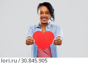 Купить «happy african american woman with red heart», фото № 30845905, снято 2 марта 2019 г. (c) Syda Productions / Фотобанк Лори