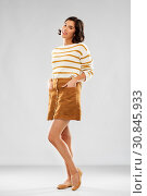 Купить «young woman in striped pullover, skirt and shoes», фото № 30845933, снято 6 марта 2019 г. (c) Syda Productions / Фотобанк Лори