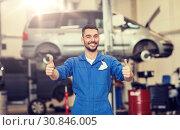happy auto mechanic man or smith at car workshop. Стоковое фото, фотограф Syda Productions / Фотобанк Лори