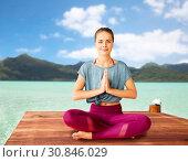 Купить «woman doing yoga and meditating in lotus pose», фото № 30846029, снято 21 июня 2018 г. (c) Syda Productions / Фотобанк Лори