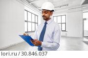 Купить «architect or businessman in helmet with clipboard», фото № 30846037, снято 12 января 2019 г. (c) Syda Productions / Фотобанк Лори