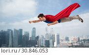 Купить «man in red superhero cape flying in air over city», фото № 30846053, снято 3 февраля 2019 г. (c) Syda Productions / Фотобанк Лори