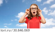 Купить «surprised or shocked teenage girl in glasses», фото № 30846069, снято 17 февраля 2019 г. (c) Syda Productions / Фотобанк Лори