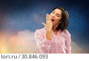 Купить «sleepy woman in pajama yawning over night sky», фото № 30846093, снято 6 марта 2019 г. (c) Syda Productions / Фотобанк Лори