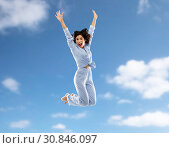Купить «happy woman in pajama jumping over blue sky», фото № 30846097, снято 6 марта 2019 г. (c) Syda Productions / Фотобанк Лори