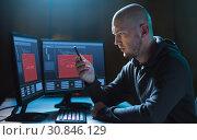 Купить «hacker with smartphone and computers in dark room», фото № 30846129, снято 9 ноября 2017 г. (c) Syda Productions / Фотобанк Лори