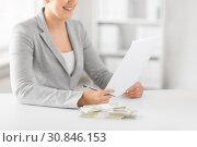 Купить «businesswoman with tax form and money on table», фото № 30846153, снято 2 июля 2015 г. (c) Syda Productions / Фотобанк Лори