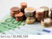 Купить «close up of euro coins and paper money banknotes», фото № 30846169, снято 30 июля 2015 г. (c) Syda Productions / Фотобанк Лори