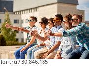 Купить «friends in sunglasses showing thumbs up in city», фото № 30846185, снято 10 июня 2018 г. (c) Syda Productions / Фотобанк Лори