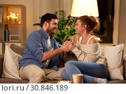 Купить «happy couple talking at home in evening», фото № 30846189, снято 5 января 2019 г. (c) Syda Productions / Фотобанк Лори