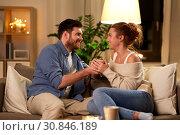 Купить «happy couple talking at home in evening», фото № 30846189, снято 5 января 2019 г. (c) Syda Productions / Фотобанк Лори