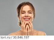 Купить «smiling young woman touching her face», фото № 30846197, снято 20 января 2019 г. (c) Syda Productions / Фотобанк Лори