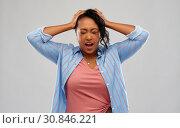 Купить «stressed african american woman holding to head», фото № 30846221, снято 2 марта 2019 г. (c) Syda Productions / Фотобанк Лори