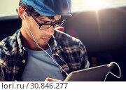 Купить «close up of man with tablet pc and earphones», фото № 30846277, снято 15 июня 2016 г. (c) Syda Productions / Фотобанк Лори