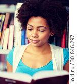 Купить «african student girl reading book at library», фото № 30846297, снято 19 июня 2016 г. (c) Syda Productions / Фотобанк Лори