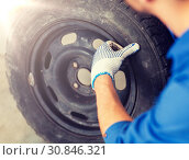 Купить «mechanic with wheel tire at car workshop», фото № 30846321, снято 1 июля 2016 г. (c) Syda Productions / Фотобанк Лори