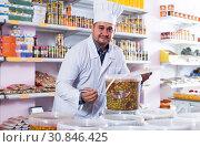 Купить «Shop staff standing near containers with olives in flavoured brine», фото № 30846425, снято 15 октября 2016 г. (c) Яков Филимонов / Фотобанк Лори