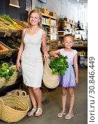 Купить «Glad mother with daughter shopping various veggies», фото № 30846449, снято 26 июня 2019 г. (c) Яков Филимонов / Фотобанк Лори