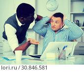 Two men in office working at laptop and documents. Стоковое фото, фотограф Яков Филимонов / Фотобанк Лори