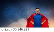 Купить «man in red superhero cape over night sky», фото № 30846821, снято 3 февраля 2019 г. (c) Syda Productions / Фотобанк Лори