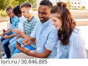 Купить «friends with smartphones and tablet pc in city», фото № 30846885, снято 10 июня 2018 г. (c) Syda Productions / Фотобанк Лори