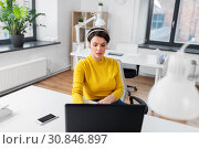 Купить «businesswoman with headphones and laptop at office», фото № 30846897, снято 23 февраля 2019 г. (c) Syda Productions / Фотобанк Лори