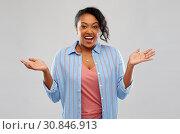 Купить «surprised african american woman shrugging», фото № 30846913, снято 2 марта 2019 г. (c) Syda Productions / Фотобанк Лори