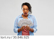 Купить «surprised african american woman with dollar money», фото № 30846925, снято 2 марта 2019 г. (c) Syda Productions / Фотобанк Лори