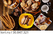 Купить «Meringue kisses, oatmeal cookies and sand chocolate cake with cherry», фото № 30847321, снято 26 мая 2019 г. (c) Gennadiy Poznyakov / Фотобанк Лори