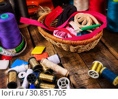 Купить «Sewing accessories coil threads and measuring tape in basket supplies», фото № 30851705, снято 19 мая 2019 г. (c) Gennadiy Poznyakov / Фотобанк Лори