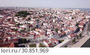 Купить «Picturesque aerial view of historical areas of Lisbon on bank of Tagus river overlooking medieval Roman Catholic Cathedral, Portugal», видеоролик № 30851969, снято 20 апреля 2019 г. (c) Яков Филимонов / Фотобанк Лори