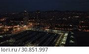 Купить «Barcelona seashore on Mediterranean in night lights, aerial view», видеоролик № 30851997, снято 27 сентября 2018 г. (c) Яков Филимонов / Фотобанк Лори