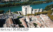 Купить «Aerial view of medieval fortified Chateau de Tarascon and Rhone river at sunny day», видеоролик № 30852029, снято 24 октября 2018 г. (c) Яков Филимонов / Фотобанк Лори
