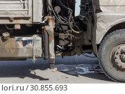 Купить «Oil and mud contaminated truck engine and transmission», фото № 30855693, снято 17 мая 2019 г. (c) Олег Белов / Фотобанк Лори