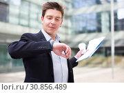 Купить «Portrait of busy man rushing to important meeting», фото № 30856489, снято 20 апреля 2017 г. (c) Яков Филимонов / Фотобанк Лори
