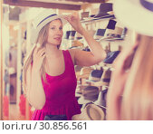 Купить «woman try on lady's hat and looking in mirror at outlet store», фото № 30856561, снято 2 мая 2017 г. (c) Яков Филимонов / Фотобанк Лори
