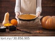 Купить «woman cooks pumpkin pie», фото № 30856905, снято 23 ноября 2018 г. (c) Майя Крученкова / Фотобанк Лори