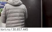 Купить «Man choosing iron door in store», видеоролик № 30857445, снято 27 апреля 2019 г. (c) Ekaterina Demidova / Фотобанк Лори