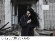 Купить «Young woman wrapping oneself up», фото № 30857645, снято 26 мая 2019 г. (c) Art Konovalov / Фотобанк Лори