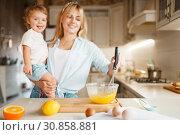 Купить «Mother and daughter mixing ingredients for cake», фото № 30858881, снято 6 марта 2019 г. (c) Tryapitsyn Sergiy / Фотобанк Лори