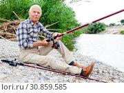 Купить «Aged man fishing at lakeside», фото № 30859585, снято 10 июня 2018 г. (c) Яков Филимонов / Фотобанк Лори
