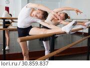 Купить «Beautiful woman and teenager poses near mirror in hall with ballet bar», фото № 30859837, снято 26 апреля 2019 г. (c) Яков Филимонов / Фотобанк Лори