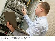 Купить «Support network service engineer with server computer equipment», фото № 30860517, снято 28 февраля 2019 г. (c) Дмитрий Калиновский / Фотобанк Лори
