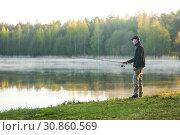 Купить «fishing. fisher with spinning rod early morning», фото № 30860569, снято 8 мая 2019 г. (c) Дмитрий Калиновский / Фотобанк Лори