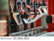 Купить «bending machine at work. process of metal sheet forming», фото № 30860605, снято 28 мая 2019 г. (c) Дмитрий Калиновский / Фотобанк Лори