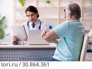 Купить «Old man visiting young male doctor», фото № 30864361, снято 9 января 2019 г. (c) Elnur / Фотобанк Лори
