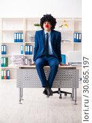 Купить «Young clown businessman working in the office», фото № 30865197, снято 14 декабря 2018 г. (c) Elnur / Фотобанк Лори